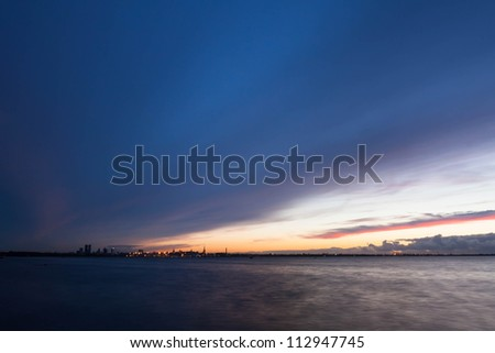 silhouette of tallinn with fire sea sunset. long exposure - stock photo