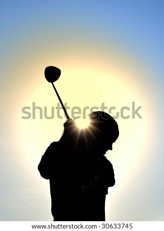 Silhouette of Teen Girl Swinging a Driver, vertical, copy space - stock photo