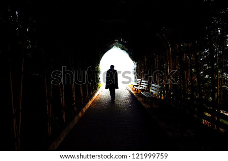 Silhouette of Teenager standing on an abstract background - stock photo