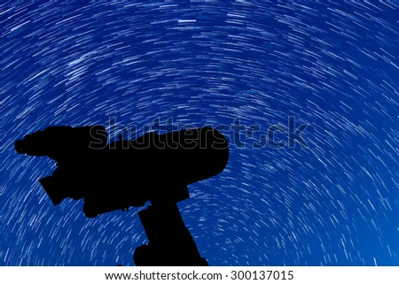 Silhouette of Telescope and beautiful star background. - stock photo