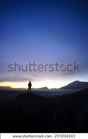 Silhouette of Tengger hikers during Sunrise at Mount Bromo Indonesia  - stock photo