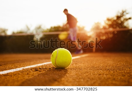 Silhouette of tennis player on a tennis court