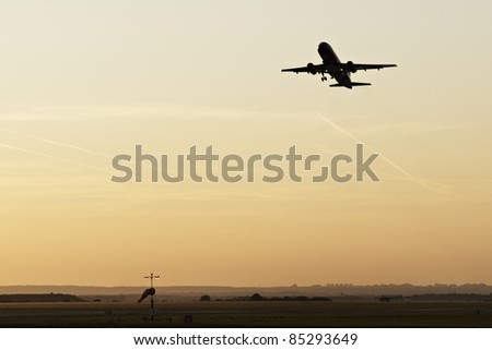 Silhouette of the airplane - evening on the Prague Airport - stock photo