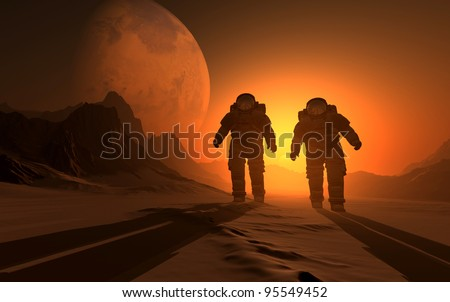 silhouette of the astronauts on the background of the sunset. - stock photo