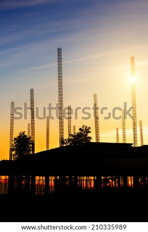 Silhouette of the building under construction - stock photo