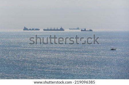 Silhouette of the cargo ship - stock photo