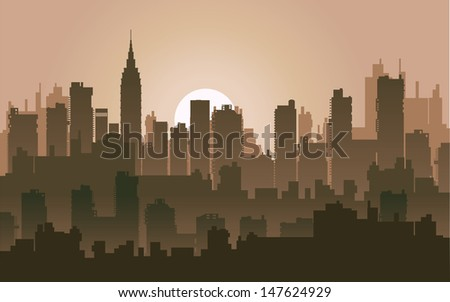 Silhouette of the city at night against the setting sun - stock photo
