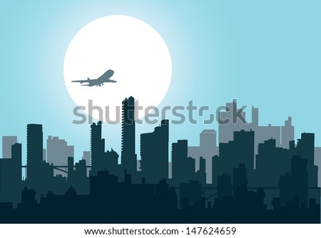 Silhouette of the city at night at sunset - stock photo