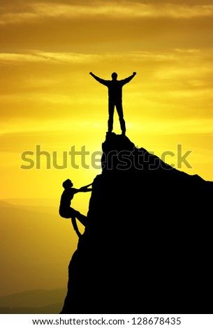 Silhouette of the climbers. Sport and active life - stock photo
