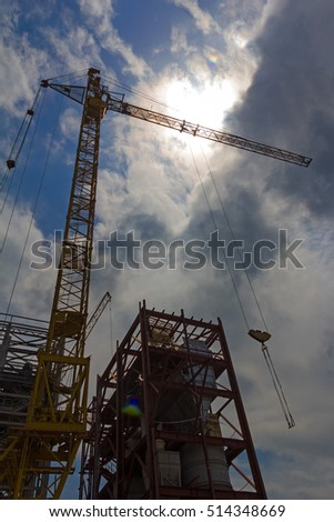 Silhouette of the crane against the sun