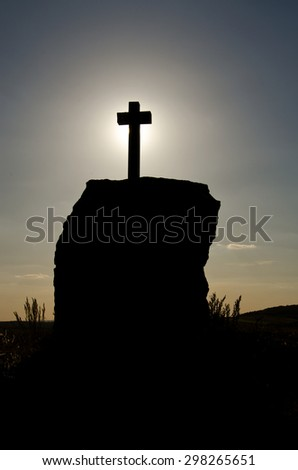 silhouette of the cross against the sky - stock photo