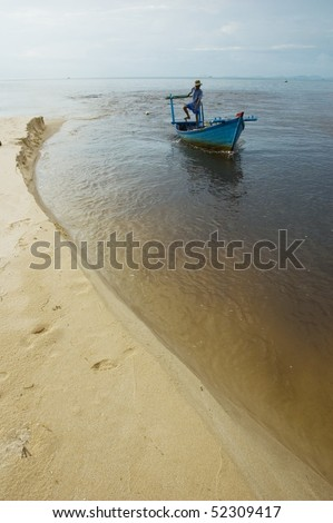 silhouette of the fisherman coming back from the sea, Phu Quoc Island, Vietnam, Asia - stock photo