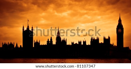 Silhouette of the Houses of Parliament and Big Ben across River Thames in London, UK - stock photo