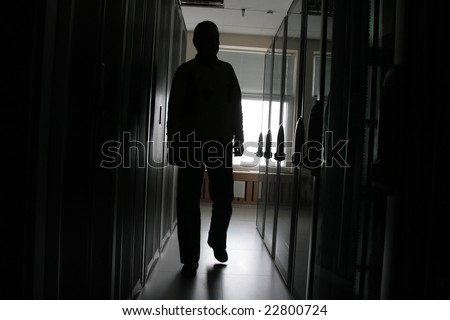 Silhouette of the man in a dark corridor