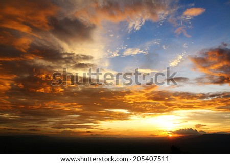 Silhouette of the mountain during sunset with beautiful colorful sky - stock photo