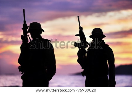 Silhouette of the new soldiers holding the firearms. While training special forces to fight terrorists for security. Under the National Security Law