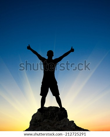 Silhouette of the person on sun glow background. Sport and active life