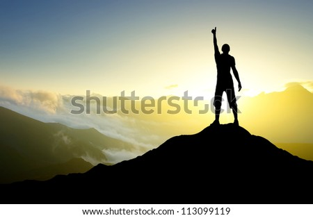 Silhouette of the person on the peak of mountain. Sport and active life - stock photo