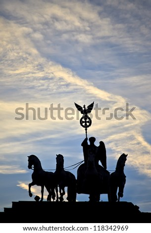 Silhouette of the Quadriga statue on top of the Brandenburg Gate, Berlin, Germany - stock photo