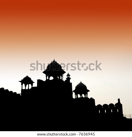 silhouette of the red fort by sunrise in delhi, India - stock photo