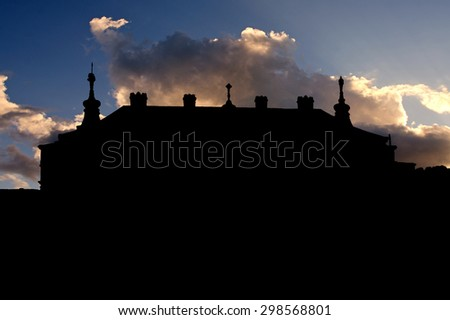 silhouette of the ruins of a medieval castle sunset - stock photo