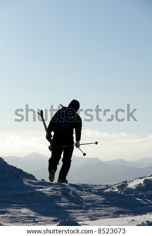 Silhouette of the skier going in mountain