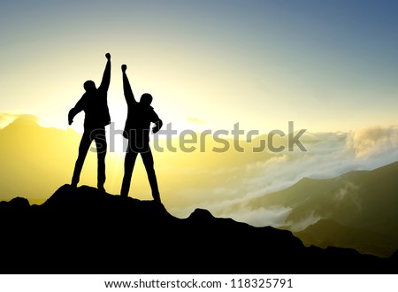 Silhouette of the team on background of sunshine. Concept and idea - stock photo