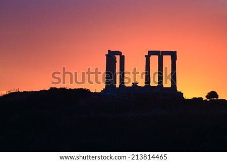 Silhouette of the temple dedicated to Poseidon at sunset, Cape Sounio, Greece