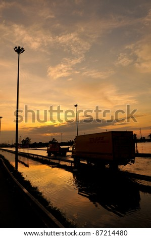 silhouette of the truck on Highway - stock photo