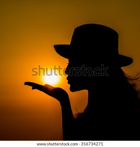 Silhouette of the woman - stock photo