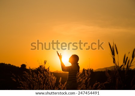 Silhouette of the women raise hand - stock photo