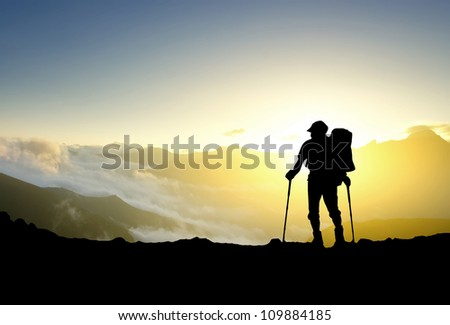 Silhouette of tourist in mountain. Sport and active life - stock photo