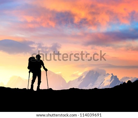 Silhouette of tourist on the top. Sport and active life