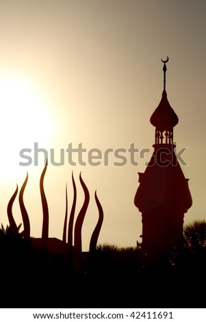 Silhouette of Tower of University of Tampa in sunset Florida - stock photo