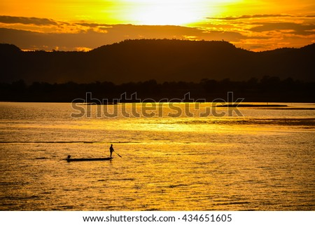 Silhouette of traditional fisherman in a lake at sunrise time