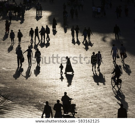 Silhouette of traditional people of Morocco in Marrakesh - stock photo