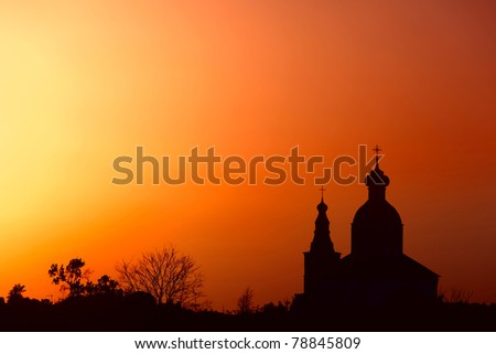 Silhouette of traditional Russian Church in ancient town Suzdal at sunset. - stock photo
