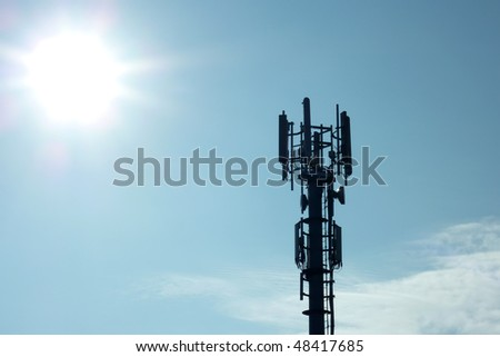 Silhouette of transmitter tower showing sun flare