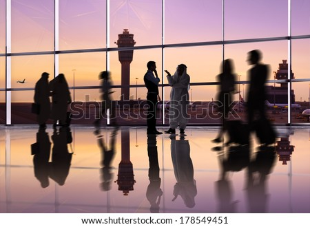 Silhouette of Traveling People at an Airport - stock photo