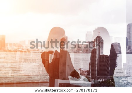 Silhouette of two businesswomen stand and look far away in Hong Kong, Asia. Double exposure. - stock photo
