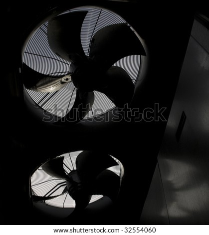 Silhouette of two fans in HVAC - stock photo