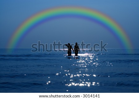 silhouette of two girls holding hands under rainbow