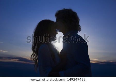 Silhouette of two lovers on the sunset