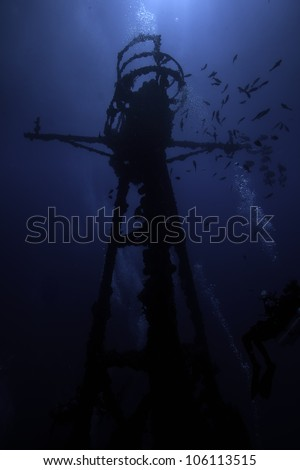 Silhouette of Underwater shipwrecks crows nest with a blue water background in Key Largo, Florida. The Coast Guard Cutter Duane in John Pennekamp State Park. - stock photo