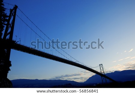 Silhouette of Vancouver's Lion's Gate Bridge  at sunrise.