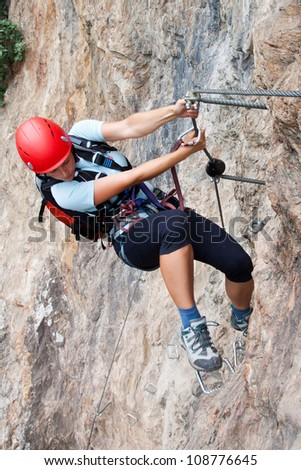 Silhouette of via ferrata/klettersteig female climber - stock photo