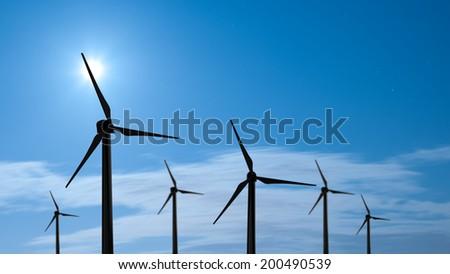Silhouette of wind turbine in night sky - stock photo