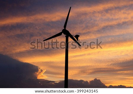 Silhouette of wind turbine on  colorful sky background,(with clipping path)