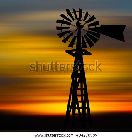 Silhouette of windmill with natural background, at sunset time. - stock photo