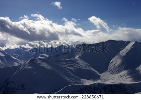 Silhouette of winter mountains at evening. Caucasus Mountains, Georgia. Ski resort Gudauri. - stock photo